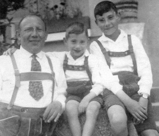 Heinz Skyte (centre) photographed with his father and brother in the 1920s. (c) HSFA.