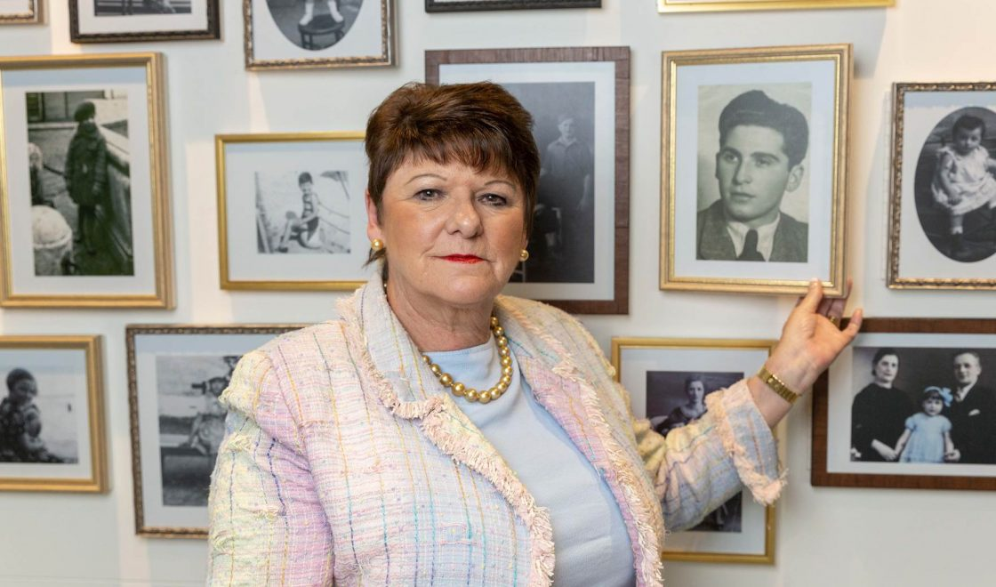 Holocaust Survivors' Friendship Association Chair Lilian Black looks at her father's image in the exhibition, 'Through Our Eyes'