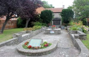 Memorial garden in Highbridge, showing plants and plaques