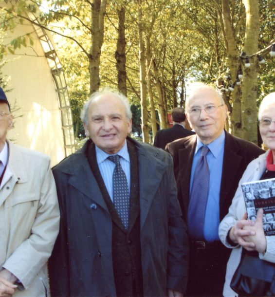 Photograph of four Holocaust survivors at a memorial event